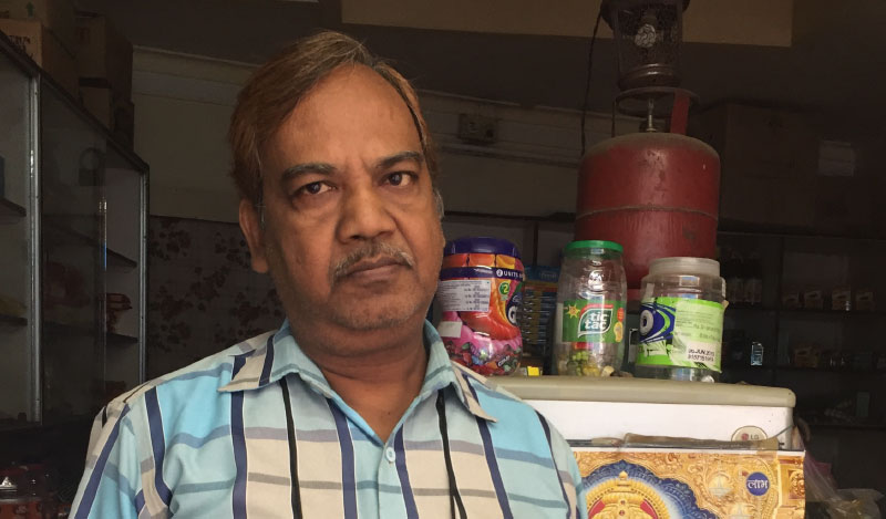 Pawan Agarwal at his general store in Jhumri Telaiya