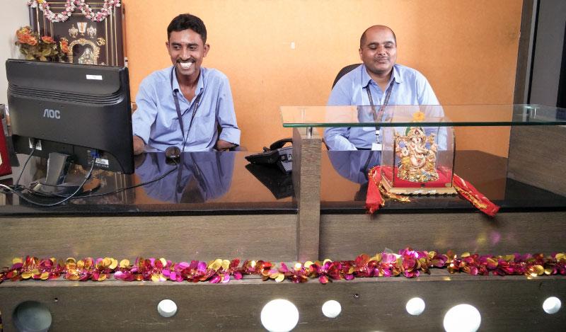 Srinivas and his visually impaired colleague Madhu at Vindhya E-Infomedia