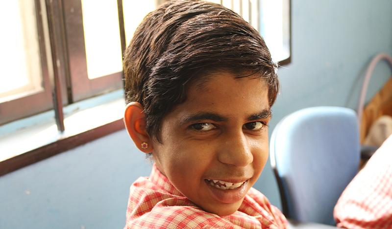 Ganesh, student at Samarthanam, painted Holi cards for Ekart